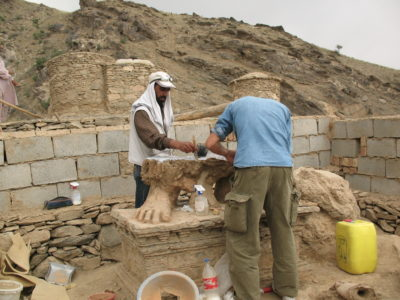 Consolidation work on the remains of a colossal clay sculpture at Tepe Narenj
